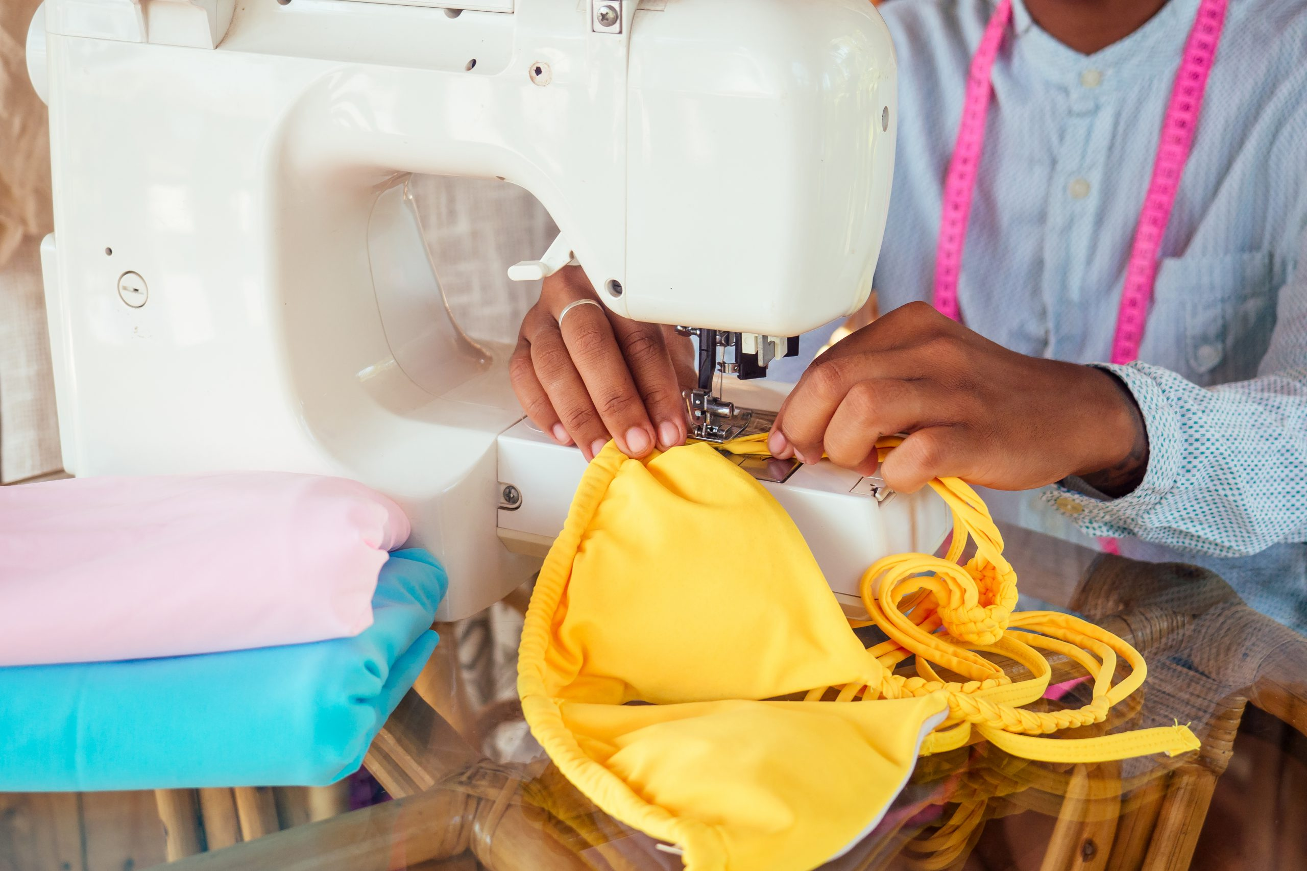 African,American,Woman,Sewing,A,Stylish,Yellow,Swimming,Suit,For