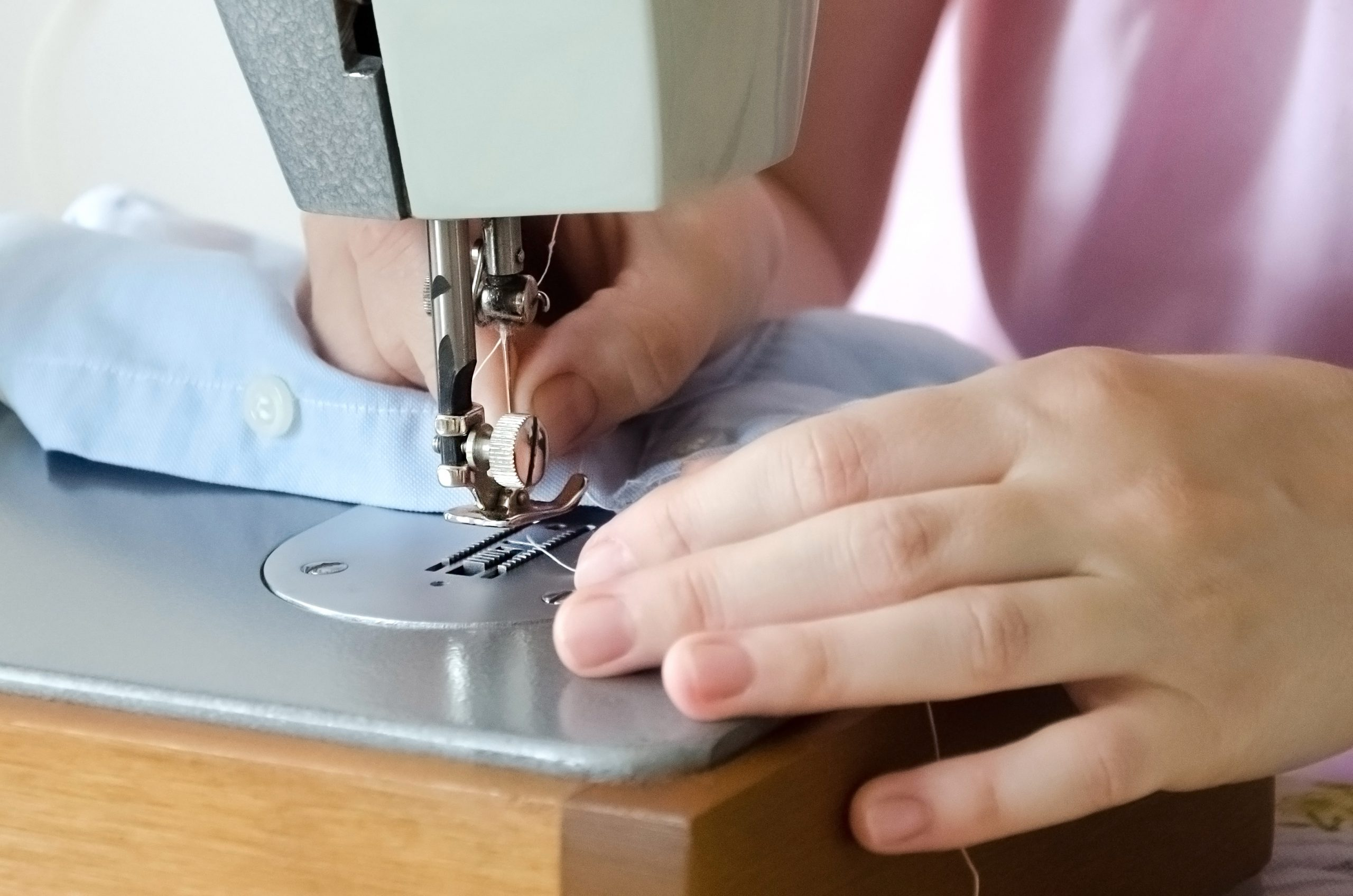 Sewing,Striped,Shirt,On,A,Sewing,Machine.,Сlose,Up